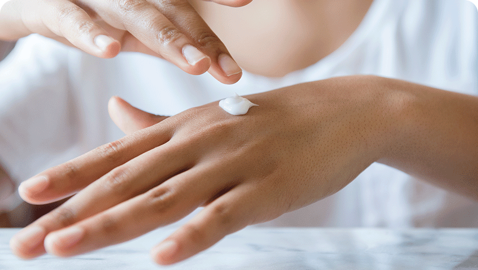 Person applying Johnson's® Baby Lotion to hands