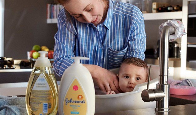 Mom giving baby bath
