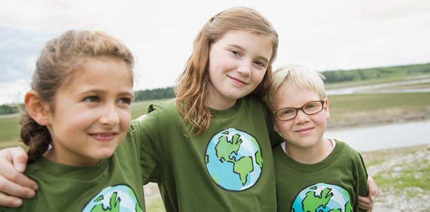 Kids in environmental earth shirts
