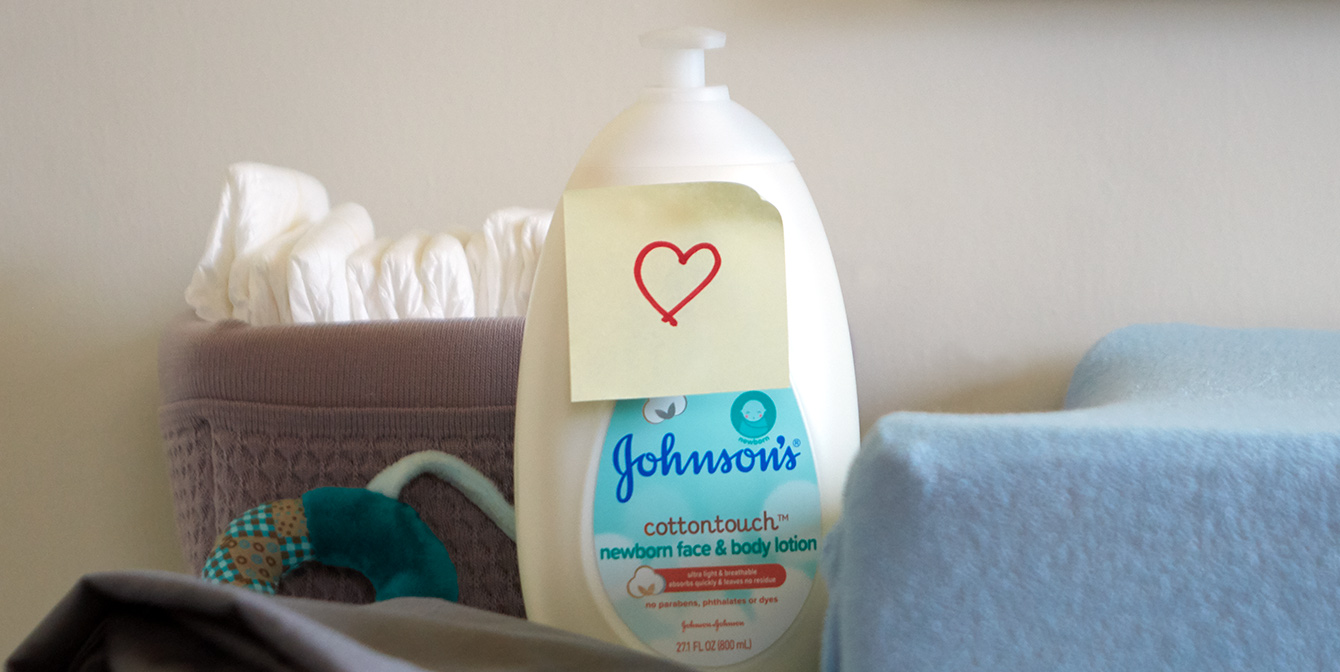 Johnson's® CottonTouch™ newborn lotion with a heart sticker