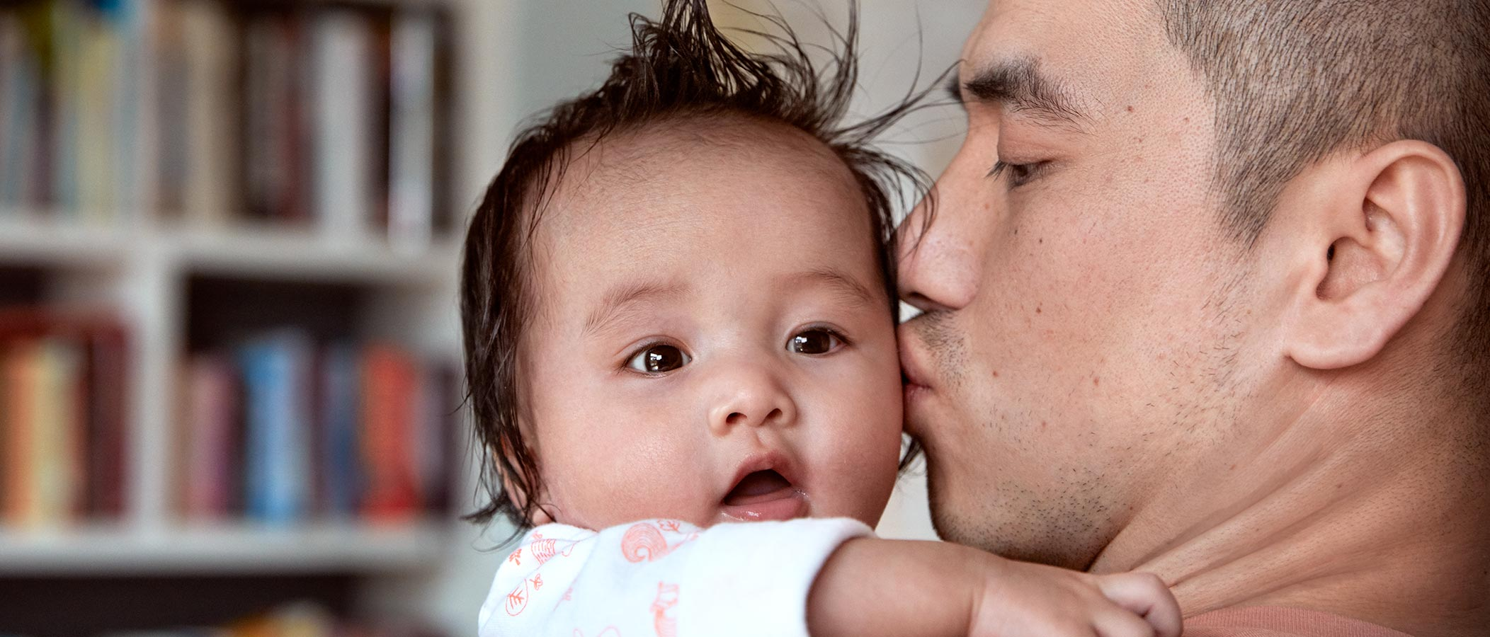 Dad kissing baby after bath time